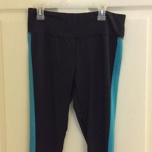Black and aqua running pants with lace inset.